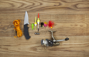 Fishing Kit with assorted equipment on aged wood