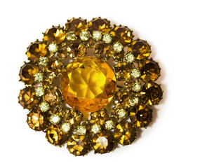 vintage golden brooch with gems in the shape of a flower