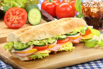 Baguette salad submarine sandwich with ham cheese and tomato on