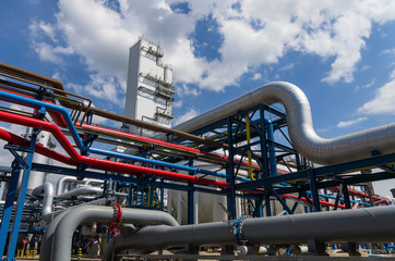 big pipelines on blue sky with clouds