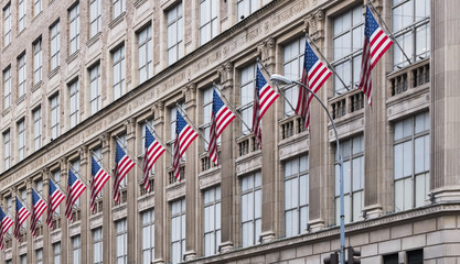 many american flags on old office building in New York