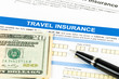 Travel insurance application form with pen model and dollar bank