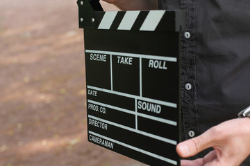 clapperboard in hands man