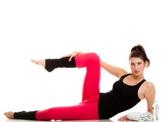 Flexible girl doing stretching pilates exercise