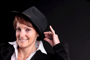 old woman wearing a hat smiling