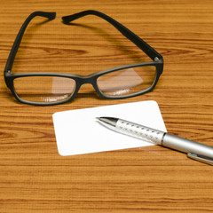 bussiness card and pen with glasses