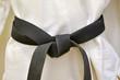 Karate Black Belt on White Uniform - 65948909