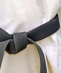 Karate Black Belt on White Uniform