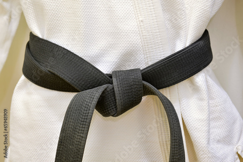 Foto Spatwand Vechtsporten Karate Black Belt on White Uniform