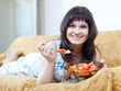 woman eats  salad at home  interior