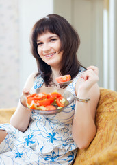 positive casual woman eats veggie salad