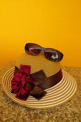 Sun Hat & Sunglasses in Orange Background