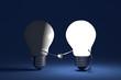 Light bulbs handshaking on blue