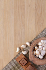 garlics with empty space wooden background