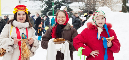 Women with pancake during  Shrovetide