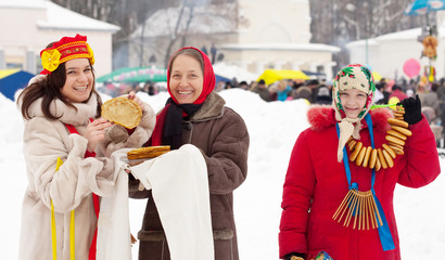 woman tasting pancake  during  Shrovetide