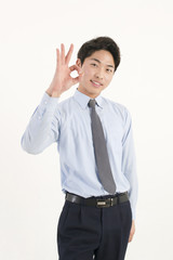 Asian young businessman giving okay sign