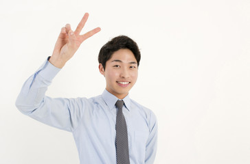 Asian young businessman with two finger peace sign hand gesture