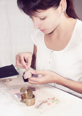 girl concentrating on hobby