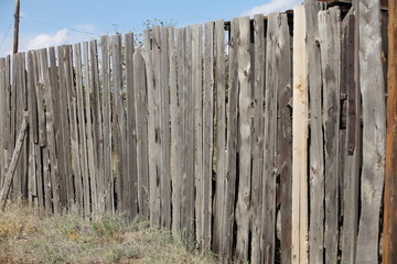 unpainted old wooden Picket  fence