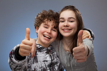 Girl and boy showing OK sign