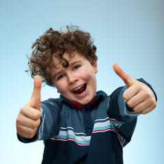 Portrait of young boy showing ok sign