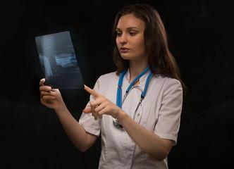 Doctor examining arm bones radiography
