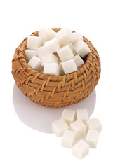 pieces of white sugar cubes in a wicker basket