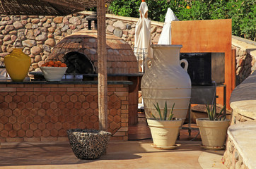 Outdoor cafe with wood counter and round oven, Egypt