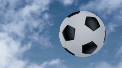 Soccer ball flies at the camera then stops but keeps rotating.