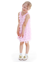 young girl in a pink dress.