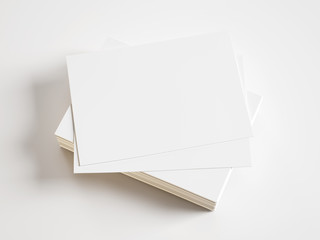 pile of blank business cards on white background