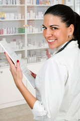 beautiful woman doctor holding medicine prescription.