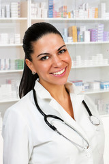Close up of a beautiful woman doctor inside farmacy.
