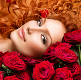 Woman with permed red hair and beautiful red roses poster