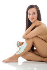 young healthy woman shaving legs