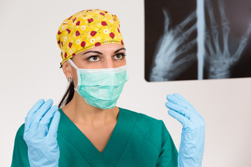 Female surgeon looking X-Ray