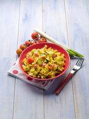 pasta with saffron cream sauce and sliced vegetables