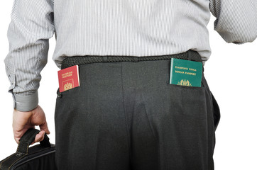 Businessman has Russian and Tonga passports in his rear pockets