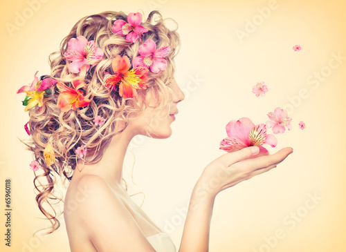canvas print picture Beauty girl takes beautiful flowers in her hands