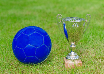 Victory celebration. Soccer trophy near the ball.