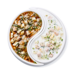 Russian Cold soup Okroshka with chopped vegetables and meat with