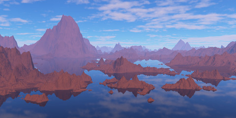Mountains surrounded by water.