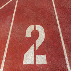 number 2 on red running track