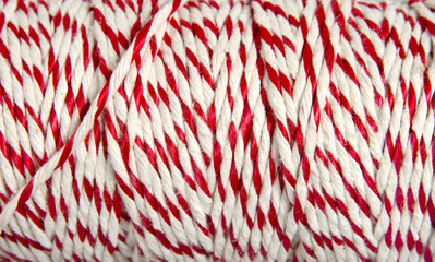 Roll of red and white rope for parcel