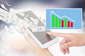 Person Using A Digital Tablet,Stock Market Provider
