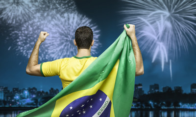 Brazilian fan celebrates the victory after the match