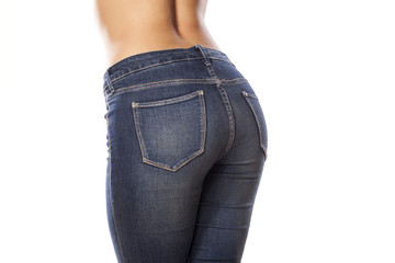 female buttocks in jeans on a white background
