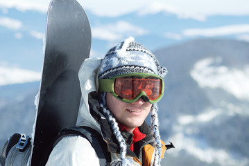 Portrait of snowboardr in the mountains