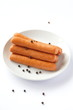 Raw frankfurter sausage and spicy on white